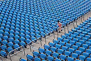 Woman running stadium steps for a training workout.