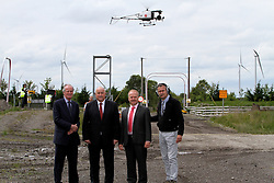 "Green Aviation Launches Ireland's Largest Drone Offering First Irish commercial drone company to operate above 20kg Max Take Off Weight 30% cheaper than current solutions 90% more fuel efficient.<br /> <br /> Pictured at the Green Aviation Launches Ireland's Largest Drone Offering were:<br /> Ulick McEvaddy, CEO of Omega Air, <br /> Brig. Gen. Ger Aherne, Chairman of Green Aviation.<br /> Oisin Green, CEO Green Aviation and former Commercial Airline Pilot, <br />  <br /> Dublin, 14th July 2015: Green Aviation, Ireland's largest commercial drone company today launched its unmanned aerial services at an event at Mount Lucas Wind Farm, Co.Offaly. The company aims to disrupt the current commercial marketplace by providing solutions up to 30% more cost efficient and 90% more energy efficient than current solutions. The drone display was the first by an Irish commercial drone company to operate a drone above 20kg Max Take Off Weight, and the first to operate a drone in the Extended Visual Line of Sight range.<br />  <br /> Green Aviation has partnered with global unmanned aerial vehicle manufacturers to provide Irish and International clients with the largest and most efficient range of services in the market. By having a selection of drones ranging from 11kg to 150kg in weight flying cameras weighing anywhere between 3kgs to 35kgs, Green Aviation is able to service a diverse market place in data collection tailored to its specific and varying needs. This platform selection, according to Green Aviation CEO and former Commercial Airline Pilot, Oisin Green, is key.<br />  <br /> ""Clients come to us with an array of different requirements and the current 'one size fits all' approach is not working for them. Utility companies for example, who currently would use helicopters to monitor the National Grid are switching to our large, industrial Inspection drone as it is silent, compared to the helicopters which are very loud- particularly at low levels which disturb livestock. Wind farm operators on the other hand, need a small, eff"