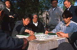CHINA BEIJING APR99 - Chinese men spend their pastime in a park near Beihai playing 'Mahjong', a traditional Chinese game. jre/Photo by Jiri Rezac