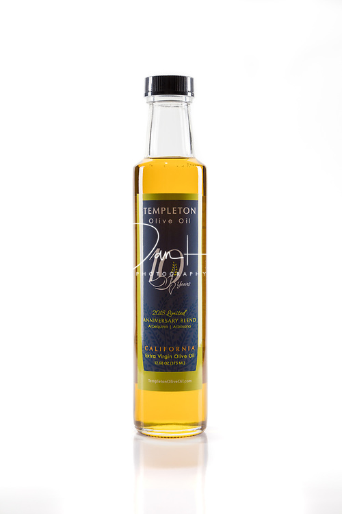 Templeton Olive Oil - for Chris Enter.<br /> Studio photography by Dan Henry / DanHenryPhotography.com<br /> <br /> * 2 ELB Strips F8 parallel with product @1.0 power<br /> &bull; Speedlite Hair directly above 1/4 .3 @ 35mm but angled to background: F11 on background with falloff at F8 on product<br /> <br /> Iso 100 / 80mm / nodal point in line with center of product
