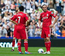 NEWCASTLE-UPON-TYNE, ENGLAND - Sunday, April 1, 2012: Liverpool's Andy Carroll and Luis Alberto Suarez Diaz look dejected as Newcastle United score their second goal during the Premiership match at St James' Park. (Pic by Vegard Grott/Propaganda)