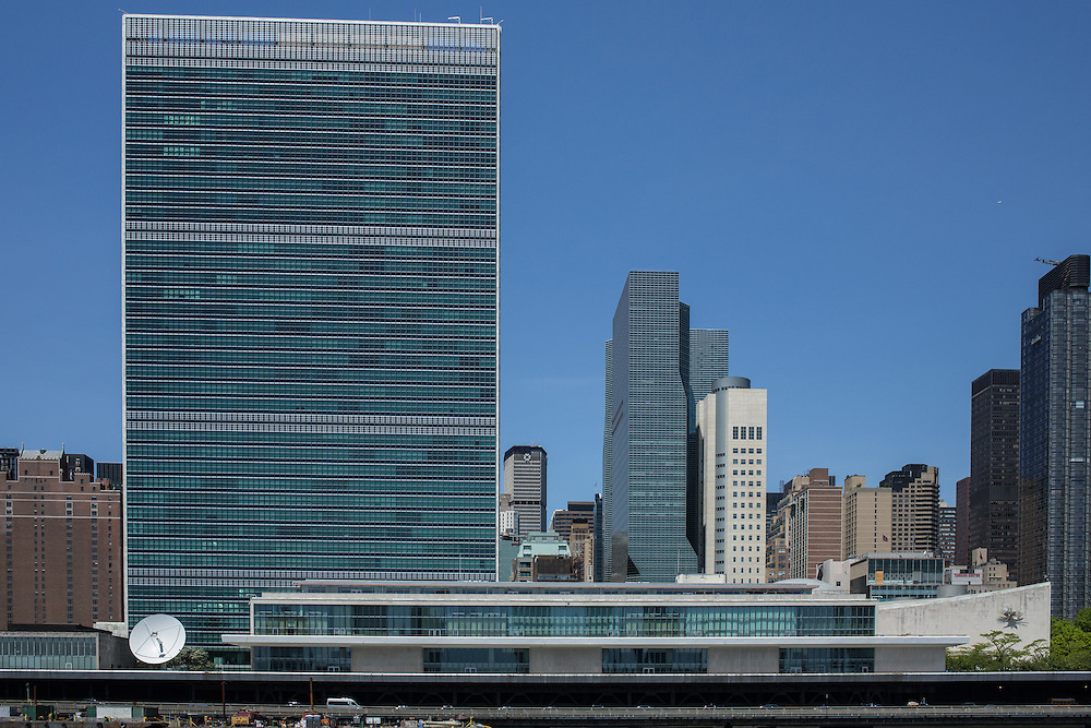 The headquarters of the United Nations, with the tall building of the Secretariat dominating the skyline, and the low horizontal Conference building facing FDR Drive and the East River.