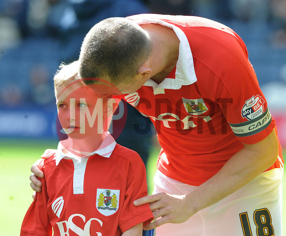Bristol City's Aaron Wilbraham speaks with the Bristol City mascot before the game - Photo mandatory by-line: Dougie Allward/JMP - Mobile: 07966 386802 - 11/04/2015 - SPORT - Football - Preston - Deepdale - Preston North End v Bristol City - Sky Bet League One