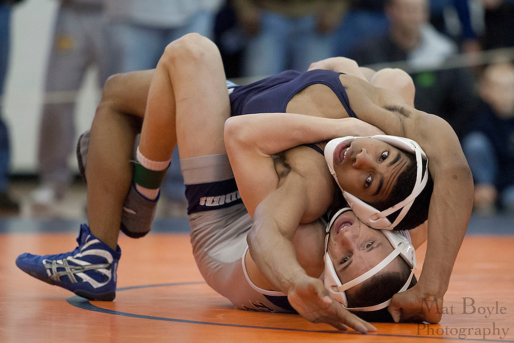 Dom Ruggierrio of Timber Creek High School vs. Sheldon Morris of Highland Regional High School during the District 30 Wrestling 145 lbs weight class Semi-final at Overbrook High School on February 18, 2012. (photo / Mat Boyle)