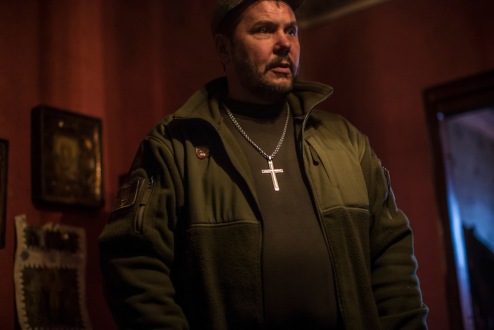 Gennadii Lysenko, a military chaplain, meets with fighters on Saturday, February 13, 2016 in Zaitseve, Ukraine.