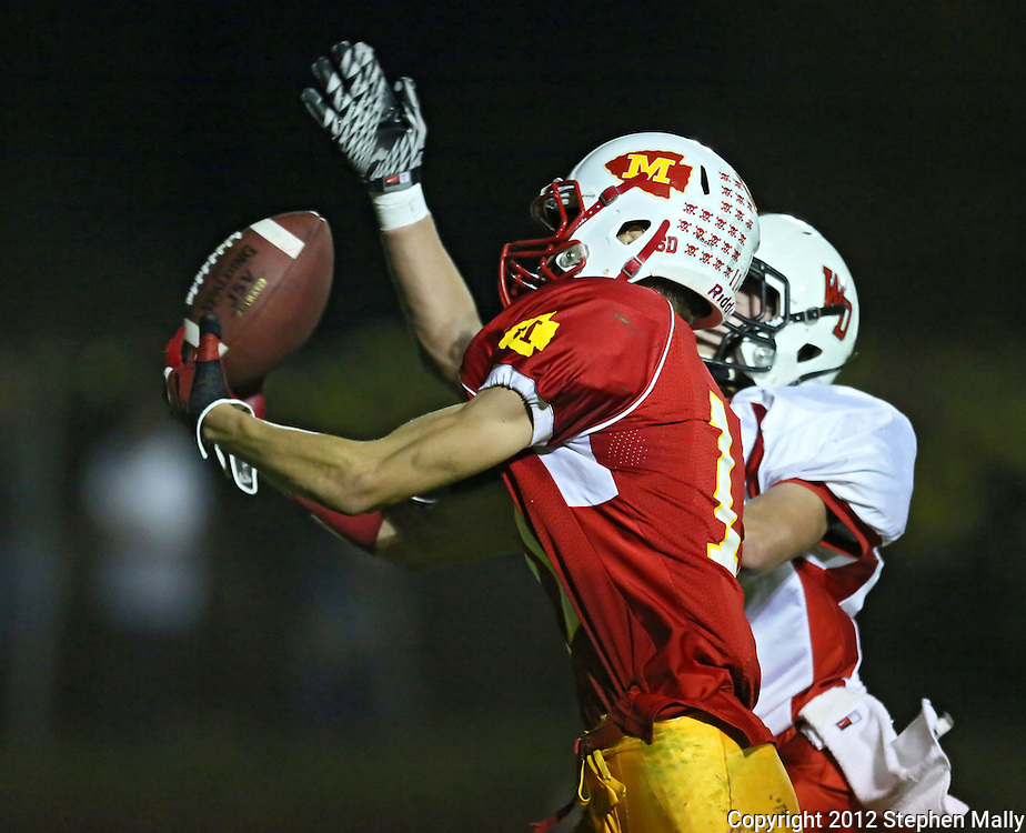Marion's Quinn Cannoy (11) can't pull in a pass as Western Dubuque's Riley Pfieler (5) defends during their first round playoff game at Thomas Park Field in Marion on Wednesday, October 24, 2012.