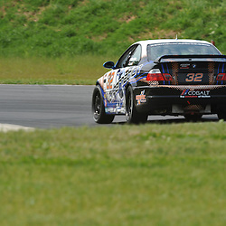 May 23, 2009; Lakeville, CT, USA; The Kinetic Motorsports BMW M3 Coupe of Glenn Bocchino, Nic Jonsson and Todd Lamb qualifies for the Grand-Am Koni Sports Car Challenge series competition during the Memorial Day Road Racing Classic weekend at Lime Rock Park.