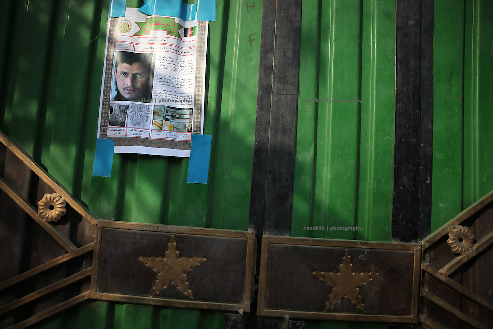 A Display of wanted suspect on a residential compound gate. In late October 2011 Kunduz based 3.Task Force started a several days operation in and around Nawabad (District Chahar Darah), west of Kunduz, northern Afghanistan. During the Operation Orpheus about 100 german infantery soldiers rolled out for patrols through the town and surrounding areas, which were expected as a retreat zone of insurgents.