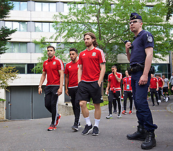 PARIS, FRANCE - Saturday, June 25, 2016: Wales' Hal Robson-Kanu, Neil Taylor and Joe Allen pass an armed French police officer during a pre-match walk outside the Mövenpick Hotel Paris Neuilly ahead of the Round of 16 UEFA Euro 2016 Championship match against Northern Ireland. (Pic by David Rawcliffe/Propaganda)