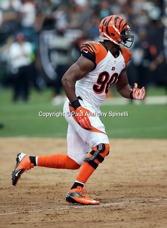 Cincinnati Bengals defensive end Michael Johnson (90) chases the action during the 2015 NFL week 1 regular season football game against the Oakland Raiders on Sunday, Sept. 13, 2015 in Oakland, Calif. The Bengals won the game 33-13. (©Paul Anthony Spinelli)