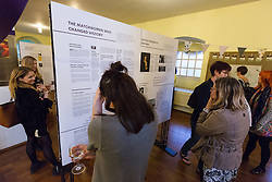 © Licensed to London News Pictures. 26/05/2016. LONDON, UK.  Guests attend the launch of 'East End Women: The Real Story' exhibition at St George-in-the-East church in Shadwell. The exhibition is a response by the East End Women's Collective and 38 Degrees following a series of protests against the nearby controversial Jack the Ripper museum, which had promised to celebrate east end women, but activists opposed and claimed glorified violence against women. A number of feminist groups and activists are still campaigning to get the  Jack the Ripper museum closed. The exhibition runs until 9th July 2016.  Photo credit: Vickie Flores/LNP