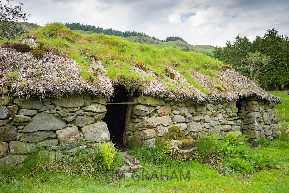 Thatched cottage old stone home at Auchindrain highland farming township settlement and village folklore museum at Furnace near Inveraray in the Highlands of Scotland
