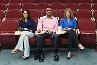 Business people sitting in auditorium