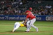 Oakland Athletics third baseman Matt Chapman (26) is tagged out by Los Angeles Angels starting pitcher Garrett Richards (43) during a pickle at Oakland Coliseum in Oakland, California, on September 5, 2017. (Stan Olszewski/Special to S.F. Examiner)