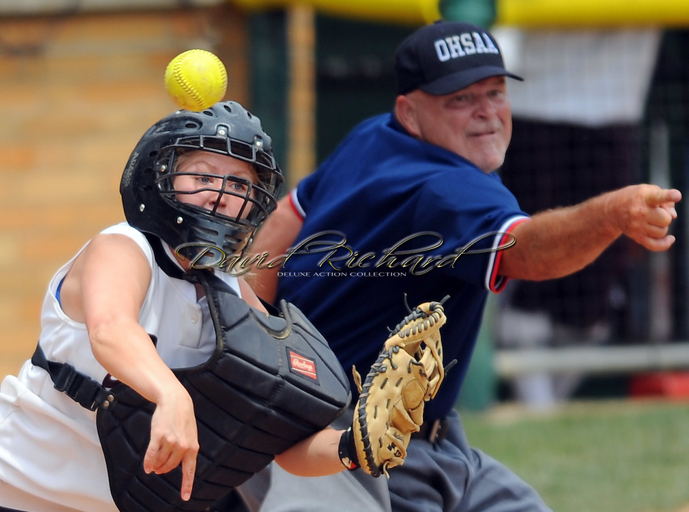 Catcher Melissa Sawyer throws to first base on a bunt base hit by Lakewood's Chelsea Riley in the third inning.