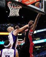 Mar. 23, 2011; Phoenix, AZ, USA; Toronto Raptors forward Ed Davis (32) puts up a basket against the Phoenix Suns center Marcin Gortat (4) at the US Airways Center. Mandatory Credit: Jennifer Stewart-US PRESSWIRE