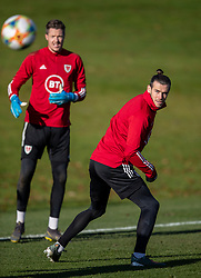 CARDIFF, WALES - Monday, November 18, 2019: Wales' captain Gareth Bale (R) and goalkeeper Wayne Hennessey during a training session at the Vale Resort ahead of the final UEFA Euro 2020 Qualifying Group E match against Hungary. (Pic by David Rawcliffe/Propaganda)