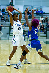 BLOOMINGTON, IL - January 04: Kaia Bowen defended by Jazmin Brown during a college women's basketball game between the IWU Titans  and the Millikin Big Blue on January 04 2020 at Shirk Center in Bloomington, IL. (Photo by Alan Look)