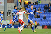 Barnsley midfielder Josh Scowen (6) battles for possession with Birmingham City midfielder Maikel Kieftenbeld (6) and Birmingham City midfielder David Davis (26) 0-0 during the EFL Sky Bet Championship match between Birmingham City and Barnsley at St Andrews, Birmingham, England on 3 December 2016. Photo by Alan Franklin.