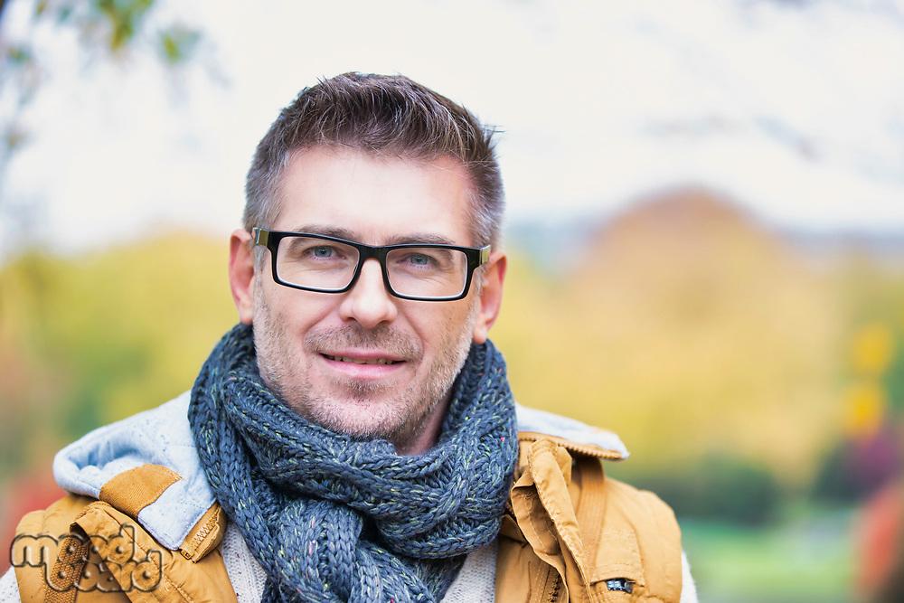 Portrait of attractive man standing in park