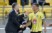 Head coach of the Phoenix Ernie Merrick (L) shakes the hand of player Ben Sigmund after his last game for the Phoenix during the A-League - Wellington Phoenix v Western Sydney football match at Westpac Stadium in Wellington on Sunday the 10 April 2016. Copyright Photo by Marty Melville / www.Photosport.nz