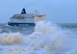 10/10/2013. Tynemouth, North Tyneside, UK, DFDS ferry Princess Seaways battles her way past Tynemouth pier, arriving  in the river Tyne from Amsterdam 9 hours late due to very poor conditions in the North Sea, and passing the pier as she would have been due to depart on her return leg. Photo credit: Adrian Don/LNP