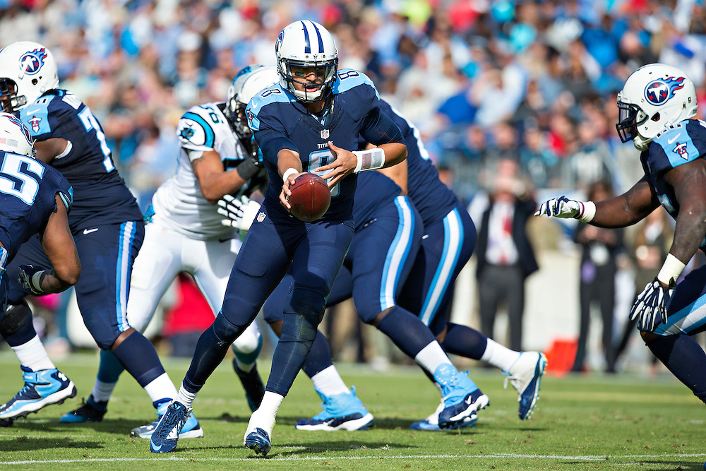 NASHVILLE, TN - NOVEMBER 15:  Marcus Mariota #8 of the Tennessee Titans turns to make a hand off in the backfield during a game against the Carolina Panthers at Nissan Stadium on November 15, 2015 in Nashville, Tennessee.  (Photo by Wesley Hitt/Getty Images) *** Local Caption *** Marcus Mariota