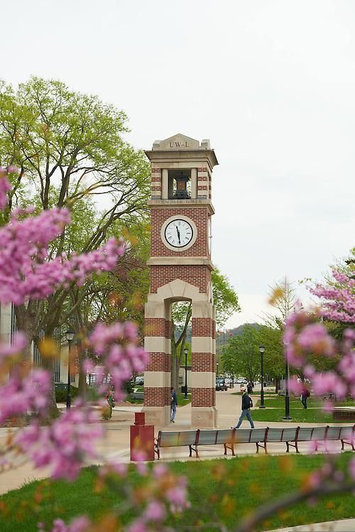 Buildings; Cowley; Clock Hoeschler Tower; Location; Outside; Objects; Flowers; People; Student Students; Spring; April; Time/Weather; day; UWL UW-L UW-La Crosse University of Wisconsin-La Crosse