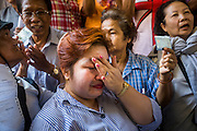 "01 FEBRUARY 2014 - BANGKOK, THAILAND:  A Thai woman cries after she was told she wouldn't be able to vote in Bangkok Sunday. Thais went to the polls in a ""snap election"" Sunday called in December after Prime Minister Yingluck Shinawatra dissolved the parliament in the face of large anti-government protests in Bangkok. The anti-government opposition, led by the People's Democratic Reform Committee (PDRC), called for a boycott of the election and threatened to disrupt voting. Many polling places in Bangkok were closed by protestors who blocked access to the polls or distribution of ballots. The result of the election are likely to be contested in the Thai Constitutional Court and may be invalidated because there won't be quorum in the Thai parliament.   PHOTO BY JACK KURTZ"