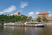 Oberhaus towering above the Danube. M.S. Johann Strauss leaving downriver...M.S. Johann Strauss, a brand new four star+ river cruiser operated by Austrian River Cruises, and chartered by Club 50 (a travel agency especially for seniors aged 50 and up) undertook an epic 3-week journey (May 21 to June 10, 2004) all the way from Amsterdam to the Black Sea?along Rhine, Main and Danube?, presumably the first passenger vessel ever to have done so. This is one of the images recorded during this historic voyage.