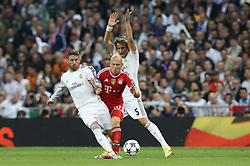 23.04.2014, Estadio Santiago Bernabeu, Madrid, ESP, UEFA CL, Real Madrid vs FC Bayern Muenchen, Halbfinale, Hinspiel, im Bild l-r: im Zweikampf, Aktion, mit Sergio Ramos #4 (Real Madrid), Arjen Robben #10 (FC Bayern Muenchen) und Fabio Coentrao #5 (Real Madrid) // during the UEFA Champions League Round of 4, 1st Leg Match between Real Madrid vs FC Bayern Munich at the Estadio Santiago Bernabeu in Madrid, Spain on 2014/04/23. EXPA Pictures &copy; 2014, PhotoCredit: EXPA/ Eibner-Pressefoto/ Kolbert<br /> <br /> *****ATTENTION - OUT of GER*****