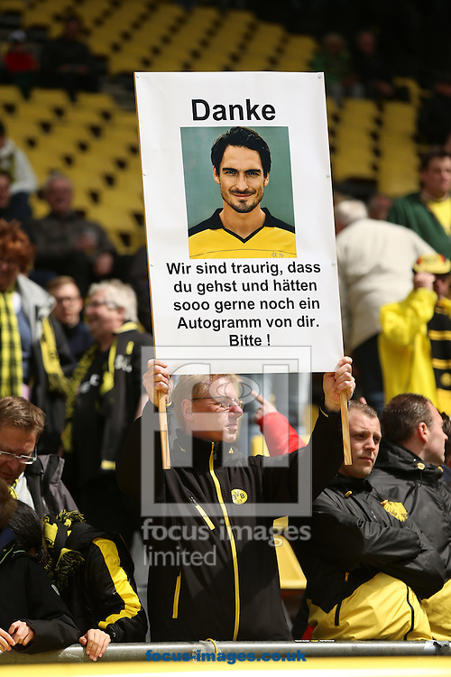 A fan of Borussia Dortmund with a poster say thanks to Mats Hummels during the Bundesliga match at Signal Iduna Park, Dortmund<br /> Picture by EXPA Pictures/Focus Images Ltd 07814482222<br /> 14/05/2016<br /> ***UK &amp; IRELAND ONLY***<br /> EXPA-EIB-160514-0068.jpg
