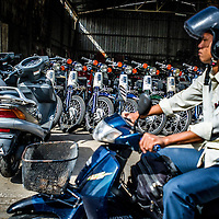 Jan 4, 2013 - A rider passes a shop of new motor scooters in the Cambodian capital city of Phnom Penh.<br /> <br /> Story Summary: Amidst the feverish pace of Phnom Penh&rsquo; city streets, a workhorse of transportation for people and goods emerges: Bicycles, motorcycles, scooters, Mopeds, motodups and Tuk Tuks roam in place of cars and trucks. Almost 90 percent of the vehicles roaming the Cambodian capital of almost 2.3 million people choose these for getting about. Congestion and environment both benefit from the small size and small engines. Business is booming in the movement of goods and and another one million annual tourists in Cambodia&rsquo;s moto culture.