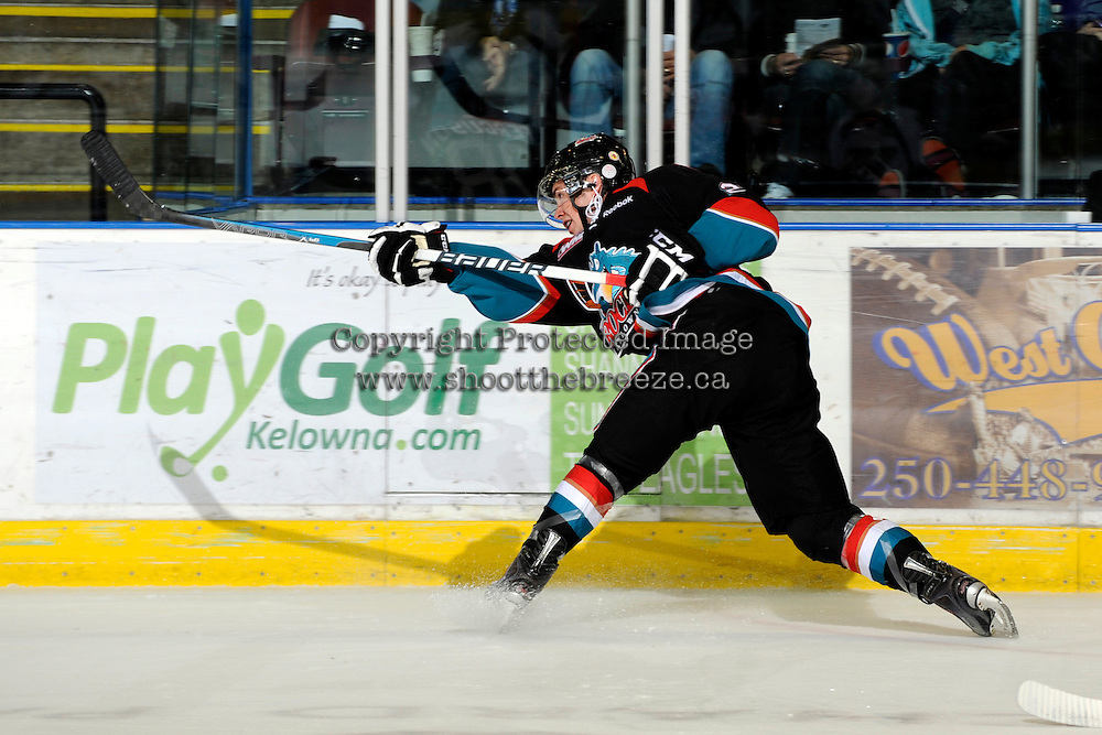 KELOWNA, CANADA, OCTOBER 5: Jesse Lees #2 of the Kelowna Rockets takes a slap shot against the Tri City Americans on October 5, 2011 at Prospera Place in Kelowna, British Columbia, Canada (Photo by Marissa Baecker/shootthebreeze.ca) *** Local Caption ***Jesse Lees;