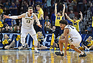 Michigan Wolverines guard Jordan Poole (2) celebrates with his teammate Moritz Wagner (13) after making the game-winning three point shot to defeat the Houston Cougars in the second round of the 2018 NCAA Tournament at INTRUST Bank Arena.
