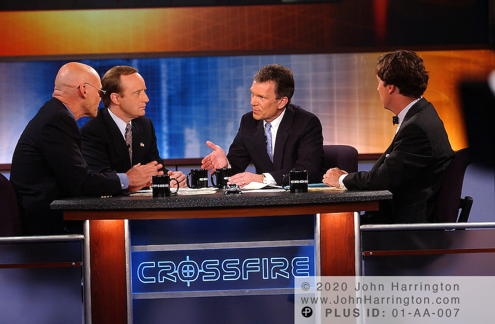 Senate Majority Leader Tom Daschle (D-SD) makes a point with James Carville, co-host of the new Crossfire, along with co-hosts Paul Begala and Tucker Carlson. CNN's Crossfire debuts in its new 7pm timeslot and has expanded to an hour-long format, in front of a live studio audience at The George Washington University.