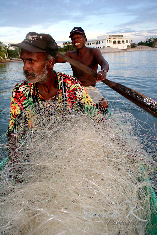 "Fishermen Mike Lopez, left, and Thomas ""Turkey"" Nunez pull in their nets each morning, hoping to find a good catch."