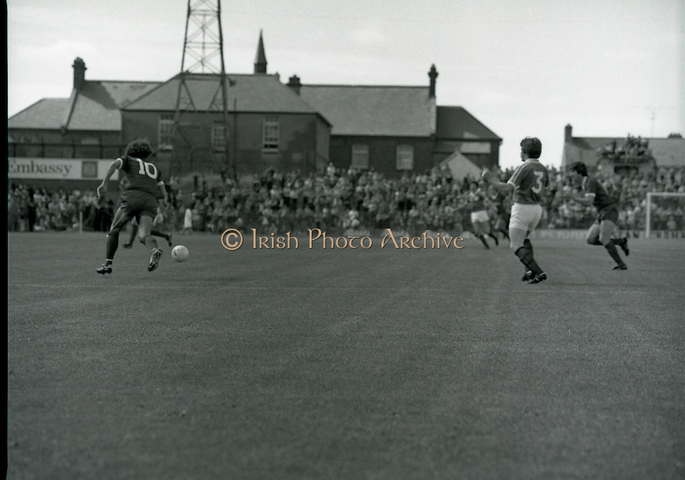 League of Ireland vs Liverpool FC.    (M87)..1979..18.08.1979..08.18.1979..18th August !979..In a pre season friendly the League of Ireland took on Liverpool FC at Dalymount Park Phibsborough,Dublin. The league team was made up of a selection of players from several League of Ireland clubs and was captained by the legendary John Giles. Liverpool won the game by 2 goals to nil..The scorers were Hansen and McDermott..Action picture of Terry McDermott (10) running to take control of the ball.