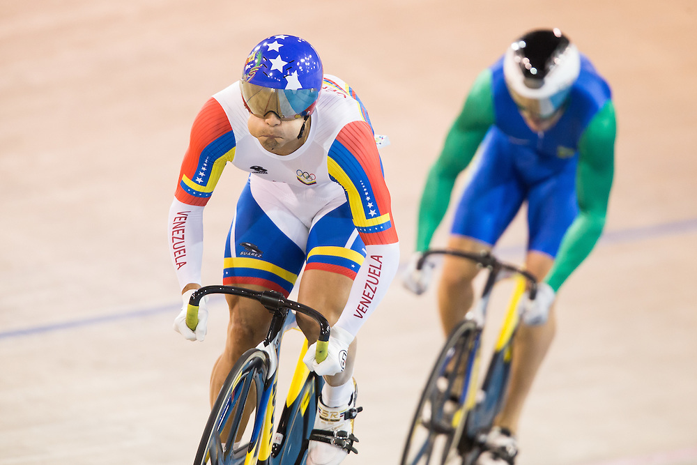 Hersony Canelon Vera of Venezuela leads Flavio Vagner Cipriano during the men's cycling sprint finals at the 2015 Pan American Games in Toronto, Canada, July 18,  2015.  AFP PHOTO/GEOFF ROBINS