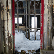 Looking inside an abandoned building of what was once a whaling station at Whalers Bay, Deception Island. Deception Island, in the South Shetland Islands, is a caldera of a volcano and is comprised of volcanic rock.