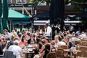 In Utrecht genieten mensen van de eerste zomerse dag van 2013 op een terras op de Neude.<br /> <br /> In Utrecht people are enjoying the first real summer day in 2013.