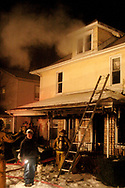 Members of the Dayton Fire Department outside of 2330 Lakeview, Thursday night.