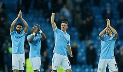 MANCHESTER, ENGLAND - Tuesday, March 15, 2016: Manchester City's Gael Clichy, Martin Demichelis and Jesus Navas celebrate reaching the Quarter-Finals after a goal-less draw and 3-1 aggregate victory over FC Dynamo Kyiv during the UEFA Champions League Round of 16 2nd Leg match at the City of Manchester Stadium. (Pic by David Rawcliffe/Propaganda)