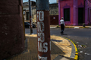 Painted poles advertise a nearby shop selling photocopy services in Spanish in Asuncion, Paraguay, Monday, Dec. 18, 2017.  Paraguay today is trying to promote a positive image of Guaraní and foster its use since the state's traditional inability to deal with Guaraní speakers has always limited the access of these people to its services, including government ministries, legal recourse and medical attention. (Dado Galdieri for The New York Times)