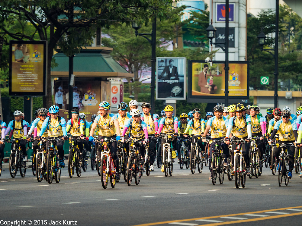 11 DECEMBER 2015 - BANGKOK, THAILAND:  His Royal Highness Crown Prince MAHA VAJIRALONGKORN, the heir apparent to the Thai crown, (center, red bike, short sleeves, blue gloves) leads the Bike For Dad bike ride in Bangkok. More than 527,000 people registered for the Bike for Dad event to honor Bhumibol Adulyadej, the King of Thailand, whose birthday is also celebrated as Father's Day in Thailand. In Bangkok, 99,999 people registered for Bike for Dad. More than 418,000 people registered for Bike for Dad rides in the provinces outside Bangkok and 9,805 participated in Bike for Dad events outside of Thailand. The Bangkok route was 29 kilometers long (18 miles) and traveled through Bangkok and across the Chao Phraya River into Thonburi. Bike for Dad events were held across Thailand.    PHOTO BY JACK KURTZ