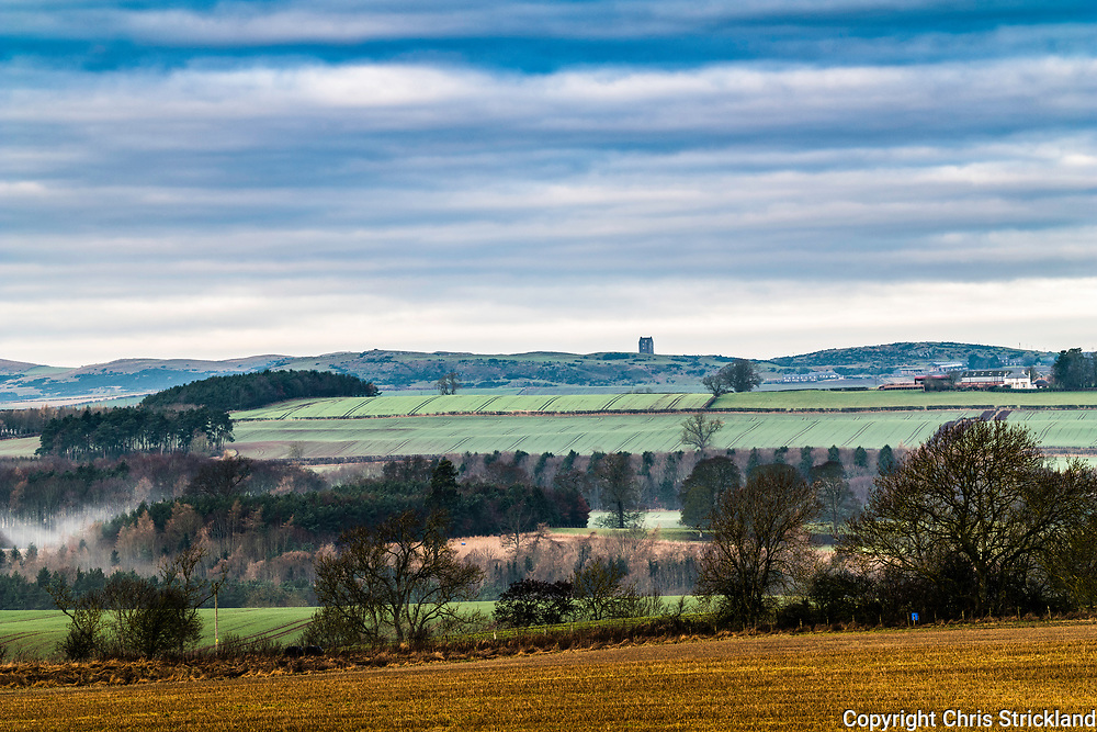 Roxburgh, Kelso, Scottish Borders, UK. 12th January 2018.  Smailholm Tower and Sandyknowes Farm on the horizon viewed from the village of Roxburgh. The tower provided inspiration to Sir Walter Scott, who visited his grandfather at the farm as a boy, and is the setting in Scott's ballad The Eve of St. John. The artist William Turner also visited the peel tower with Scott and this then provided inspiration for the photographic pioneer Fox-Talbot and his publication 'Sun Pictures in Scotland'.