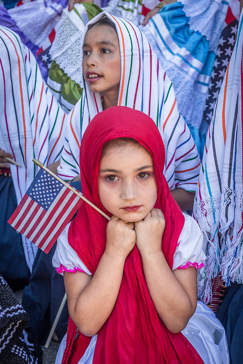 "Elina Ixchel Rodriguez (front) and Melina Rubio, members of the Saint Helena's Ballet Folklorico ""El Valle"", contemplate their participation just minutes before start of the Calistoga Fourth of July Parade"