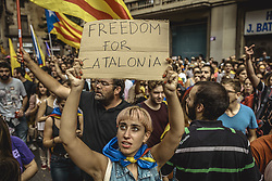 October 3, 2017 - Barcelona, Catalonia, Spain - Thousands of Catalan pro-independence activists shout slogans as they march through Barcelona during a general strike in defense of rights and freedoms after police violence during the secession referendum at October 1st. Spain's Central Government denies that there have been a referendum and does not accept the result as the Catalan referendum law had been suspended by Spain's constitutional courtCatalan pro-independence with their placards take part in a march during a general strike in defense of rights and freedoms after police violence during the secession referendum at October 1st.  (Credit Image: © Matthias Oesterle via ZUMA Wire)