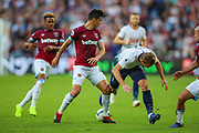 Tottenham Hotspur forward Harry Kane (10) is tackled by West Ham United defender Fabian Balbuena (4) during the Premier League match between West Ham United and Tottenham Hotspur at the London Stadium, London, England on 20 October 2018.