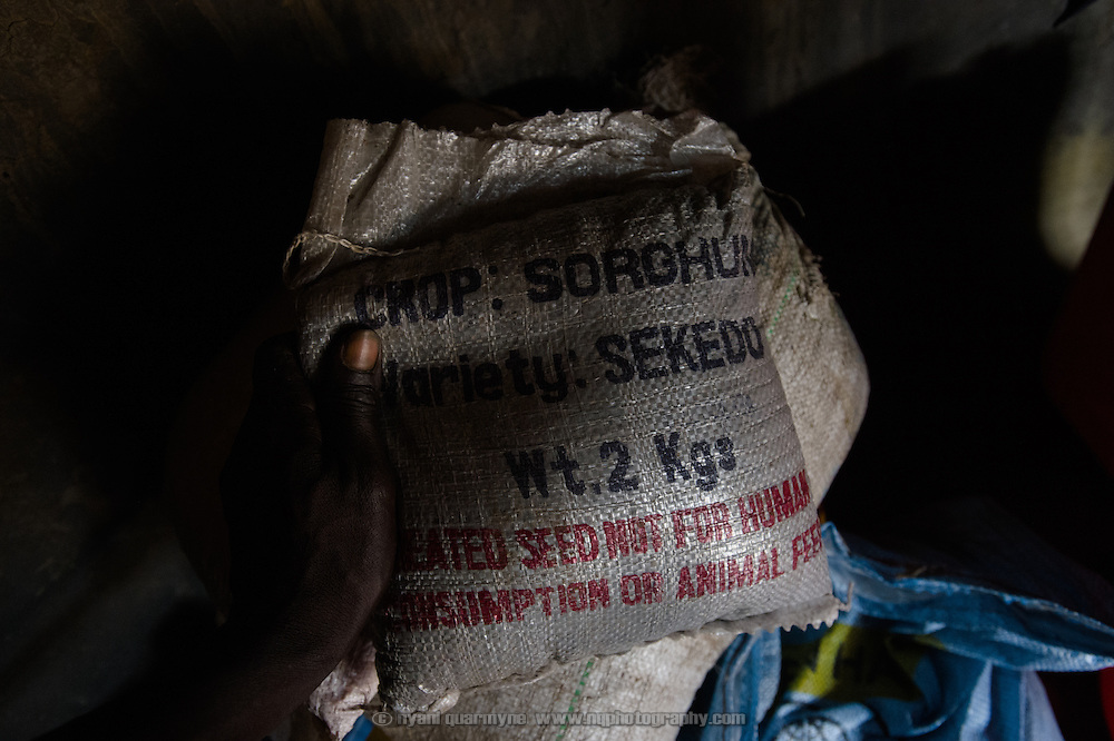 A sack of sorghum seed received during a Plan International distribution is seen at the home of Simon Jackson in the village of Kudo in Eastern Equatoria in South Sudan on 8 August 2014. Due to a combination of drought in some parts of the country, the ravages of pests in others, and instability caused by war, many South Sudanese are facing acute food shortages and possibly famine.